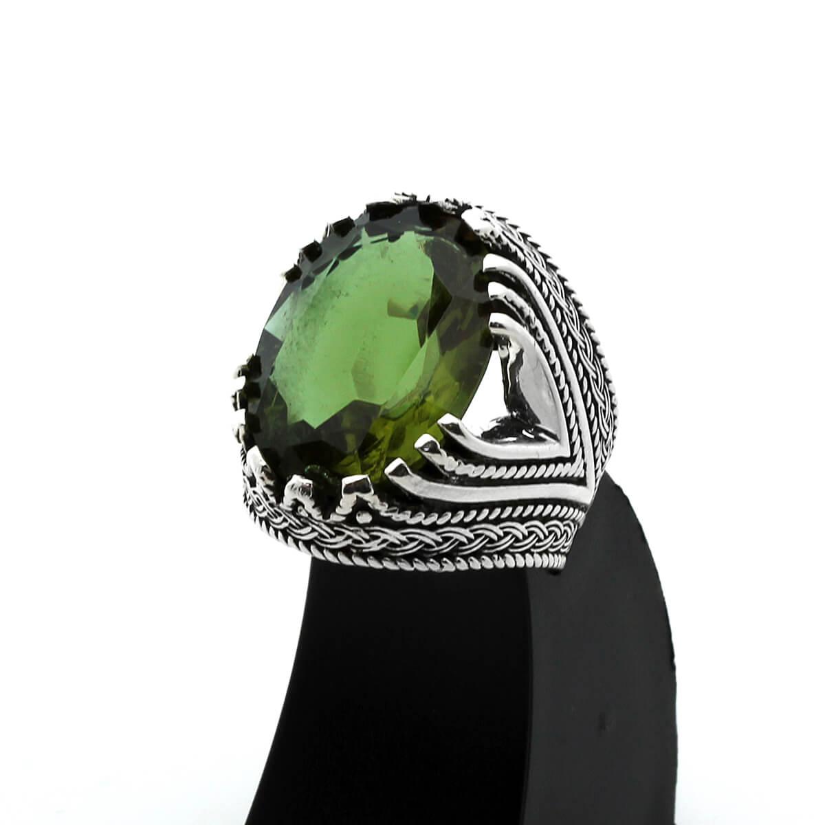 خاتم رجال من الفضة التركية عيار 925 مرصع بحجر السلطانيت الطبيعي متغير الالوان ( 95 دولار )
